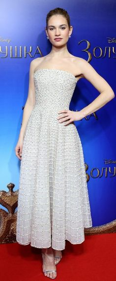 """Lily James in Nicholas Oakwell Couture attends the Moscow premiere of """"Cinderella"""". #bestdressed"""