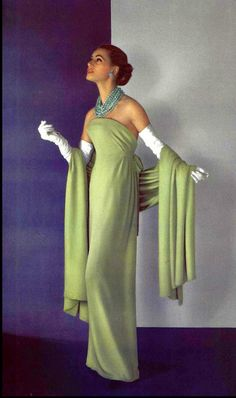 ~1956 Model in beautiful fluid green crêpe evening gown, narrow belt is tied on the sides worn with matching stole by Christian Dior, photo by Pottier~