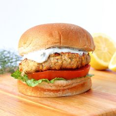 Lemon Dill Salmon Burgers are a quick, easy, and affordable way to get your seafood fix, thanks to canned salmon. Cook the patties on the grill or stove top and serve with a dollop of homemade yogurt dill sauce for a refreshing salmon burger the whole family will love! | www.bytesizednutrition.com