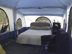 This large cabin tent is big enough to comfortably fit a bed and a couch in it.