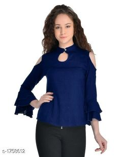 Checkout this latest Tops & Tunics Product Name: *Women's Solid Navy Blue Rayon Top* Fabric: Rayon Sleeve Length: Three-Quarter Sleeves Pattern: Solid Multipack: 1 Sizes: S, M, L, XL Country of Origin: India Easy Returns Available In Case Of Any Issue   Catalog Rating: ★4.1 (411)  Catalog Name: Women's Rayon Tops & Tunics CatalogID_230612 C79-SC1020 Code: 092-1758612-186