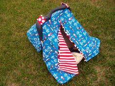3 in 1 Car Seat Canopy, Nursing Cover, and Blanket--Dr Seuss Cat in the Hat--Great for boy or girl. $39.99, via Etsy.