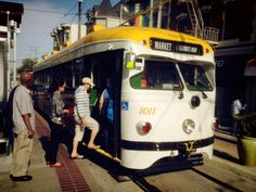 Market Street Railway Co. streetcar no. 1011, boarding at the Castro District F-line stop.