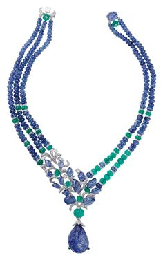 L'Odyssée de Cartier Parcours d'un Style 'India' 'high jewellery necklace in platinum, set with a 67.94ct carved sapphire, melon-cut sapphire, emerald beads, sapphire carved leaves and diamonds.