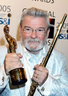 "Sir James Galway OBE (born 8 December 1939) is a virtuoso flute player from Belfast, Northern Ireland, nicknamed ""The Man With the Golden Flute""."