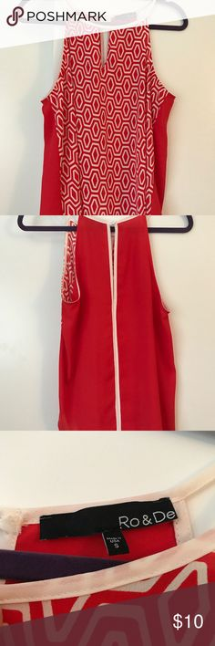 Funky red going out top Very comfy and cute with jeans. It has a geometric pattern in the front and solid on the back Tops Blouses