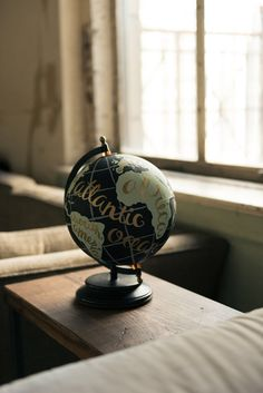 This one of a kind hand painted globe of the world is uniquely hand crafted to make it the perfect focal piece for your home. The globe pictured