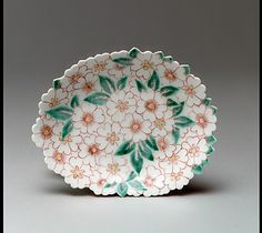 Dish with Design of Cherry Blossoms  Period: Edo period (1615–1868) Date: ca. 1650 Culture: Japan Medium: Porcelain with overglaze enamels (Hizen ware, early Nabeshima type) Dimensions: H. 1 1/4 in. (3.2 cm); Diam. 6 1/4 in. (15.9 cm) Classification: Ceramic