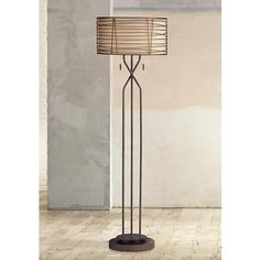 The Marlow floor lamp features a handsome bronze finish and a burlap drum shade.
