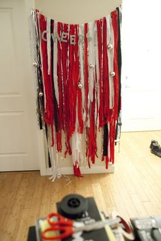 Photo Booth do for Halloween party - Cherish this looks like a bunch of crepe paper that's been strung up with letters/or a banner.