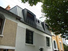 Une surélévation de maison en zinc réalisée par le constructeur You à Nantes.