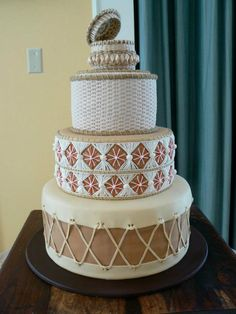 Native American Inspired Drums Wedding Cake Keywords: #weddings #jevelweddingplanning Follow Us: www.jevelweddingplanning.com  www.facebook.com/jevelweddingplanning/