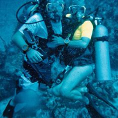 Debi and Brice diving the Cayman Islands.