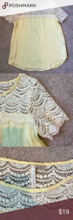 Beautiful pale yellow flowing top Worn only a handful of times. Can be dressed up or down. I love the soft pale yellow bottom part. The top part is the wow factor. Great condition, just a little wrinkled from being packed away. Upper 100% cotton. Lower 100% polyester. LC Lauren Conrad Tops