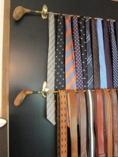 vintage golf club ties, belt and hat rack Something to do with his vintage golf clubs