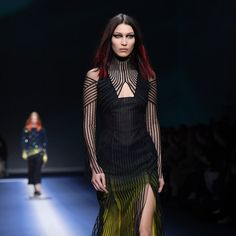 Bella Hadid's hair has received quite a lot of attention during Milan Fashion Week. The Internet buzzed when she walked her first runway with a shoulder-length lob and a significantly darker shade of brunette (it's now nearly black).