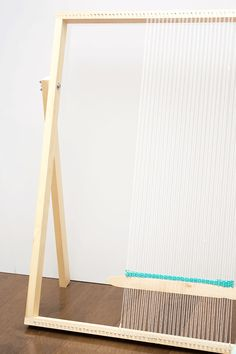 How To Make a Standing Loom With Adjustable Legs. This simple, straightforward DIY loom tutorial is intended to get you weaving in no time. Weaving Loom Diy, Rug Loom, Braided Rag Rugs, Rag Rug Tutorial, Lucet, Halloween Prop, Adjustable Legs, Passementerie, Weaving Projects