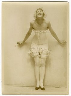 """This wonderful old still was taken by Charles Gates Sheldon at his Carnegie Hall studio where he created advertising pastels and paintings for lingerie companies, Fox Shoes, Breck Shampoo (he originated the """"Breck Girl"""" campaign), and movie magazine cover portraits. Sheldon maintained his Carnegie Hall studio in New York City during the 1920s and 1930s and photographed the glamorous Hollywood film stars of the era for his cover portrait work."""