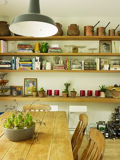 In the kitchen extension, sleek stone-coloured units sit alongside a rustic farmhouse kitchen table and open oak shelves. These are piled with earthenware confit pots and Le Parfait jars, all picked up during Rauter's time in France. Divertimenti sells classic kitchen equipment.