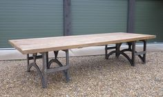 """Substantial Reclaimed Table With Polished Iron Bases is 12ft in length and 54"""" wide. This would be a great table for those who like to host dinner parties."""