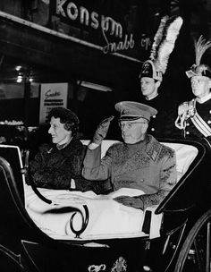 King Gustaf VI Adolf of Sweden and queen Louise Mountbatten of Sweden acknowledging the greetings of the crowd as they drove through the streets for...