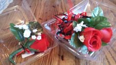 Red Rose wrist corsage and boutonniere with black accent