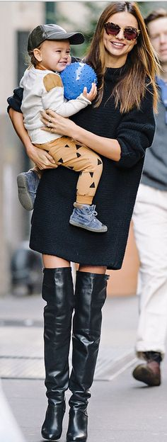Who made  Miranda Kerr's black thigh high boots and cat eye sunglasses?