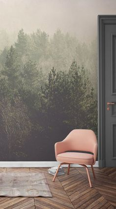 Daydream away overlooking these beautifully crisp treetops. This forest wallpaper mural brings together gentle greens with soft peachy hues. It's perfect for modern living spaces looking for a different way to dress the walls. Green and pink decor