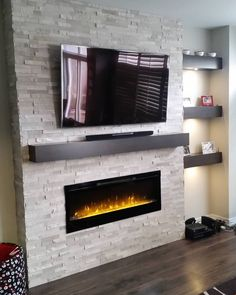 40 Awesome Modern Fireplace Decor Ideas And Design - Living Room Design Modern Fireplace Decor, Fireplace Tv Wall, Wall Mount Electric Fireplace, Small Fireplace, Fireplace Remodel, Fireplace Design, Fireplace Ideas, Fireplace Stone, Modern Electric Fireplace