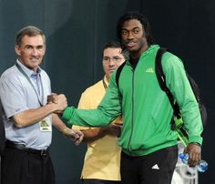 Robert Griffin III with Mike Shanahan and Danny Snyder