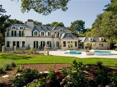 Beautiful French Style mansion in California. It needs some more flowers outside to add to the overall theme.