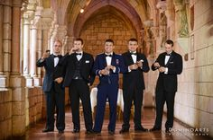 The bride, carried a beautiful #crystal accented #bouquet of #white #roses, walked to meet her soon-to-be husband in his striking military uniform, who waited for her at the #altar of the Monastery with Fr. Gustavo there to perform the #ceremony. #Portrait of the #groom and his #ushers by #DominoArts #Wedding #Photography (www.DominoArts.com)