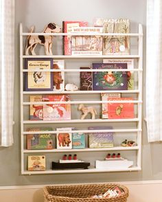 A ready-made plate rack can be easily transformed into a child's bookshelf, displaying both toys and children's books. You can also make your own shelves; just have all the wood cut to size at a lumberyard.