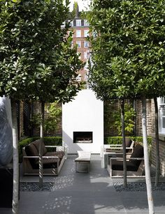 the ultimate outdoor living room in a London city garden, outdoor fireplace, table & seating surrounded by green, stone, & gravel Outdoor Rooms, Outdoor Gardens, Outdoor Living, Outdoor Sitting Areas, Small Courtyard Gardens, Outdoor Patios, Small Gardens, Modern Landscaping, Backyard Landscaping