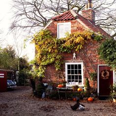 The family's 17th Century English cottage is tucked away in the heart of the village. Red bricks, sash windows - and farmyard animals, of course - add to the New England-meets-Old England feel of this home.