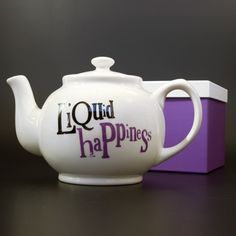 Liquid Happiness teapot ... Brown Betty shape teapot in white with phrase written on the side in purple, ceramic