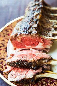 So elegant! Perfect for entertaining. Tender oven-roasted rack of lamb, seasoned with rosemary, thyme, garlic, salt and freshly ground black pepper, and slathered with olive oil. #paleo #LowCarb #Glutenfree #Easy On SimplyRecipes.com