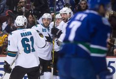 San Jose Sharks forward John Scott is all smiles after linemate Chris Tierney scored a goal (March 3, 2015).