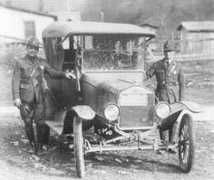 West Virginia State Police - 1922 (note the Thompson SMG on the passenger-side window-frame)