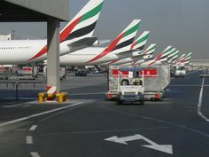 This is a photo showing airplanes from Emirates Airline at Dubai International Airport in Dubai, United Arab Emirates on 23 September 2007