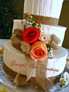 Rustic Wedding Cake with Burlap and Roses... and I would want to add a sunflower in with the roses