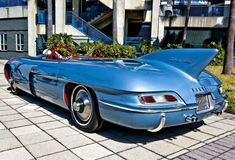 """1956 Pontiac Club de Mer Motorama Showcar Club de Mer was powered by a V8 with two four-barreled carburetors. This sleek two-seater had a rear transaxle with independent rear suspension. It had a 104"""" wheelbase, was 180"""" long and 37"""" high. A crush grain vermillion leather interior harmonized with the cerulean blue paint scheme. Source: www.gmphotostore.com www.welovepontiacs.com"""