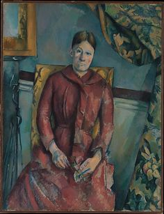 Paul Cézanne - Madame Cézanne (Hortense Fiquet, 1850–1922) in a Red Dress, 1888/90. The Metropolitan Museum of Art, New York.| The mottled blue wall, the dark red band that edges the wainscoting, and the mirror over the fireplace at left identify the setting as the apartment that Cézanne rented at 15 quai d'Anjou, Paris, from 1888 to 1890.