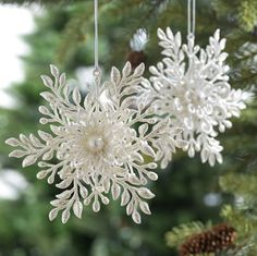Make Something Similar::Make Flat Snowflakes w/hot glue gun, layer them together. Or maybe you could use wedding floral pics?
