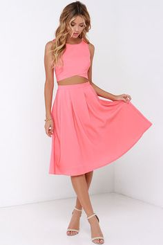 """Achieve twice the amount of style in half the time with the Nifty-Fifty Coral Two-Piece Dress! A lovely woven poly fabric is shaped into a cropped, sleeveless bodice with a rounded neckline, darting, and a chic envelope hem. Matching skirt has cute box pleats above a full, midi-length shape with a high-waisted fit. Exposed gold zipper at back. Fully lined. Small top measures 14.5"""" long. Small bottom measures 25.5"""" long. 100% Polyester. Hand Wash Cold. Imported."""