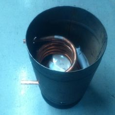 Diy Wood burning water heater to turn a paddling pool into a hot tub