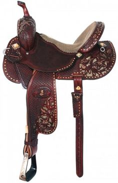 Pozzi Pro Barrel Racer by Double J Saddlery- Brittanys saddle for the 2011 NFR with a gold stingray seat, chestnut leather, bright gold buckstitch & topaz crystals.