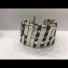 Uno de 50 bracelet Wide bracelet consisting of various silver-plated metal rectangular blocks separated from each other by brown leather knots. 100% authentic, comes with cloth Uno de 50 bag. Retails at $185. Uno de 50 Jewelry Bracelets