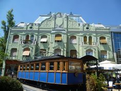 The Menrath palace, built in art nouveau style in 1908 and a former tram (photo by László Mojzer)