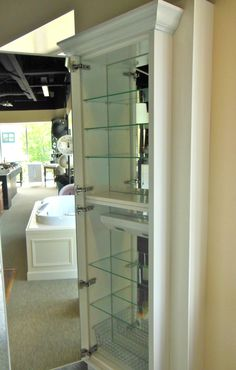 Huge bath cabinet... Roburn mirrored bathroom storage...  if bath fixtures could be glamourous...